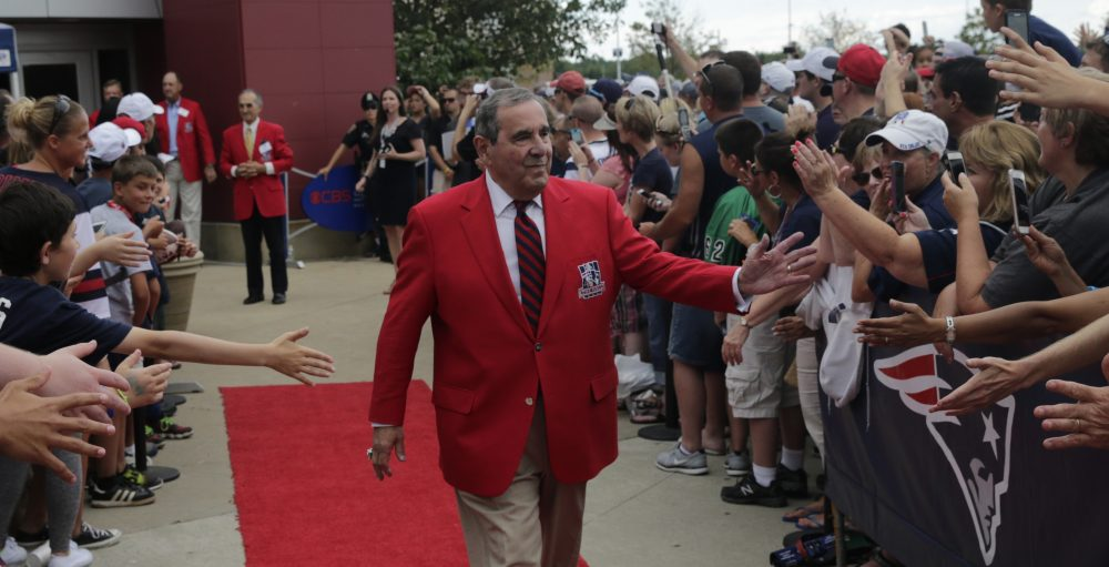 Former New England Patriot announcer Gil Santos outside the Patriots Hall of Fame prior to an NFL football training camp in Foxborough on Aug. 5, 2015. (Charles Krupa/AP)