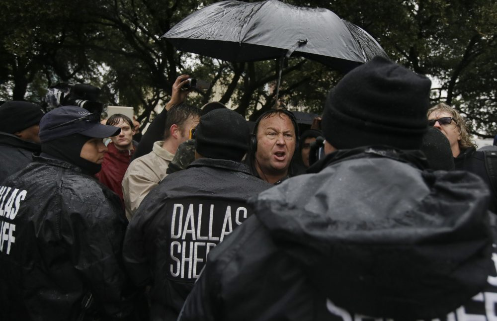 Talk show host Alex Jones leads a protest after a ceremony to mark the 50th anniversary of the assassination of John F. Kennedy, Friday, Nov. 22, 2013, at Dealey Plaza in Dallas. (Tony Gutierrez/AP)