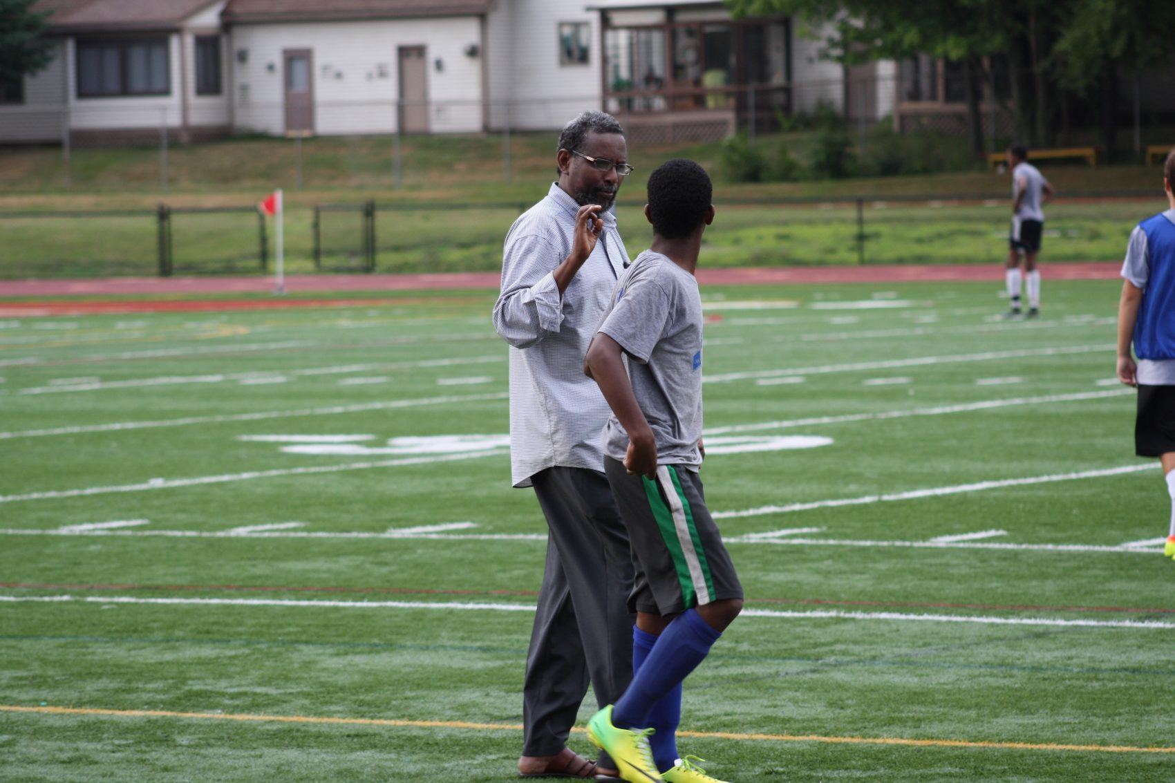 Assistant coach Abdijabar Hersi (left). (Courtesy of Amy Bass)