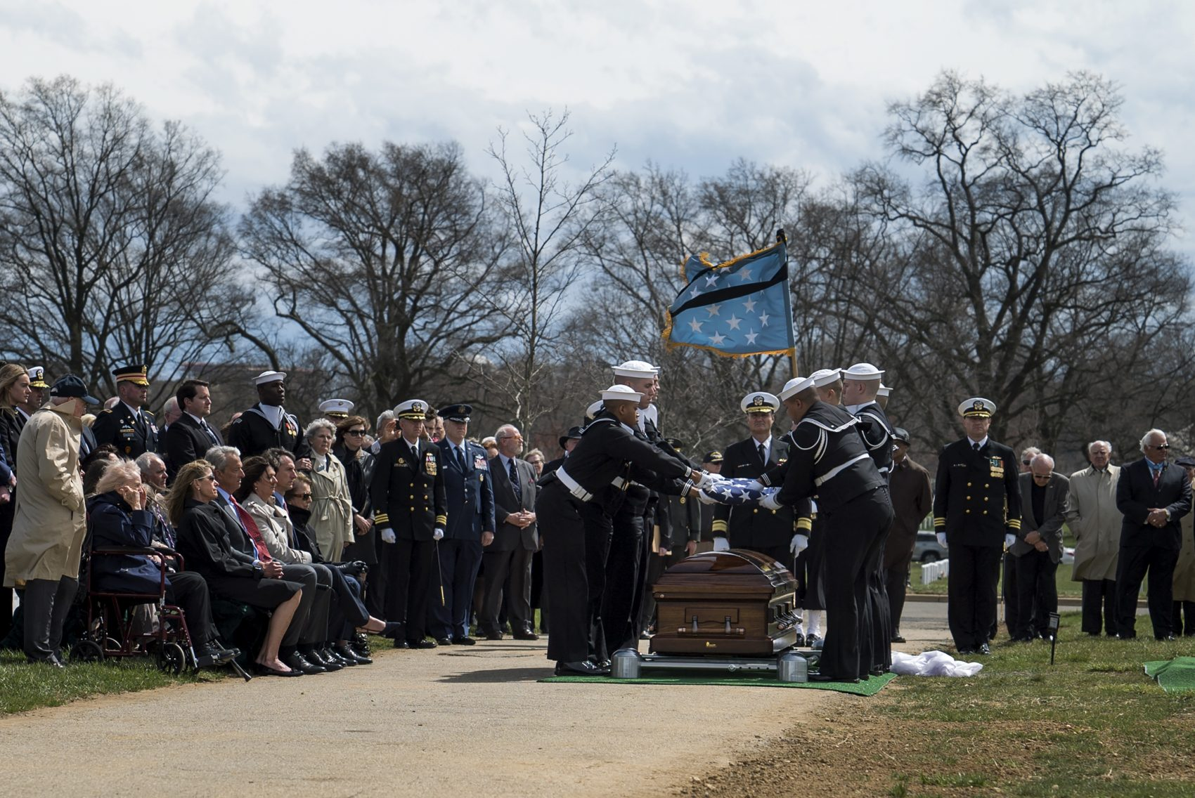 Navy Capt. Thomas Hudner Jr. is laid to rest at Arlington National Cemetery on April 4. Hudner was a naval aviator who was awarded Medal of Honor during the Korean War. (Eslah Attar/NPR)