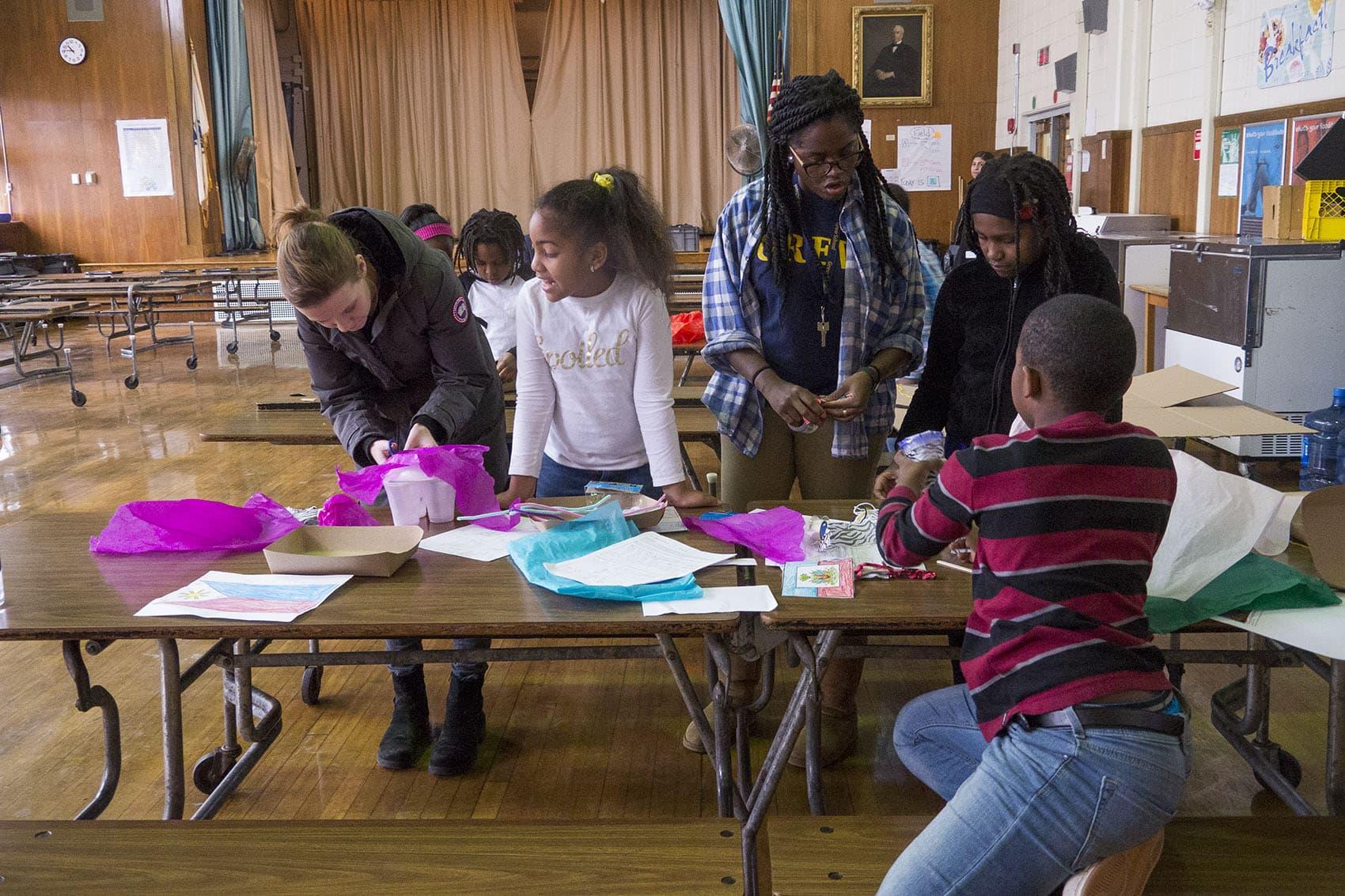 "Teacher Natasha Gordon works with students during the Grew Elementary ""acceleration academy."" (Max Larkin/WBUR)"