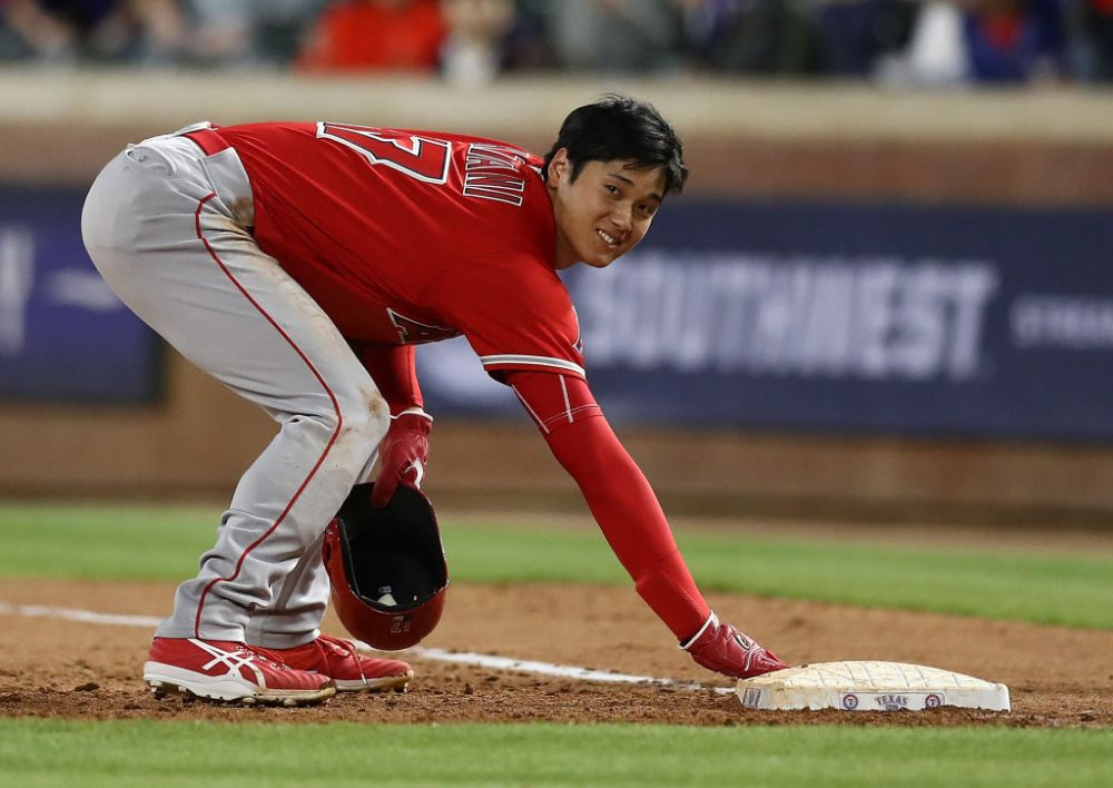 Whether pitching, hitting or getting picked off of first base, Angels' rookie Shohei Ohtani loves baseball. And he wants to play more of it. (Ronald Martinez/Getty Images)