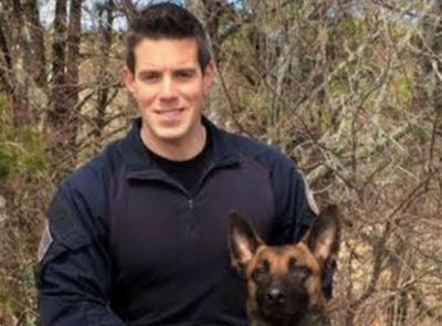 Yarmouth Officer Sean Gannon, who was killed in the line of duty on Thursday, with his dog, Nero (Courtesy Massachusetts State Police)
