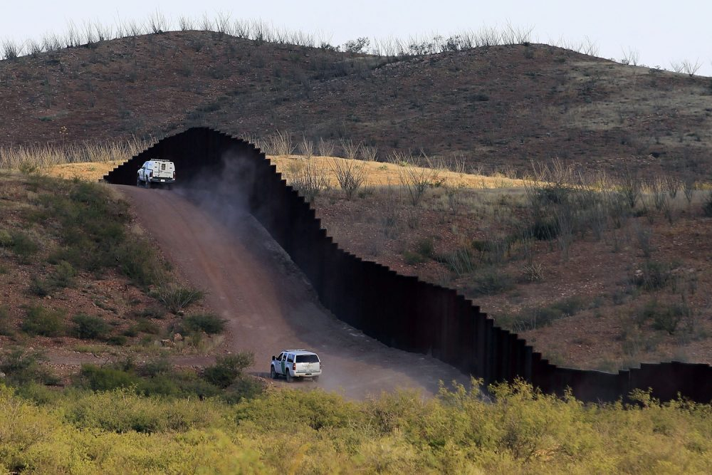 In this 2012 file photo, U.S. Border Patrol agents patrol the border fence in Naco, Ariz. (Ross D. Franklin/AP)