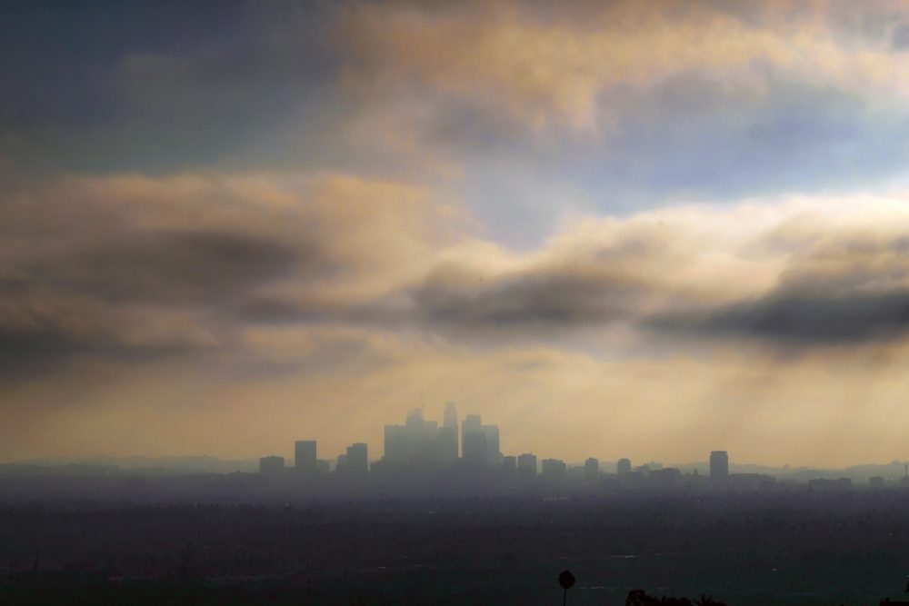 FILE - In this Aug. 12, 2016, file photo, downtown Los Angeles is shrouded in early morning coastal fog. California air regulators voted Friday, March 24, 2017, to keep the state's tough vehicle emissions standards through 2025. The state Air Resources Board voted unanimously at a meeting in Riverside to continue with the standards for 2022 to 2025 after reaching a conclusion similar to one by the U.S. Environmental Protection Agency under the Obama administration. (AP Photo/Richard Vogel, File)