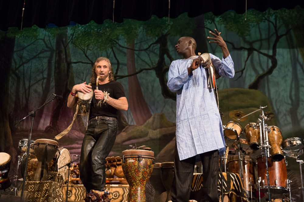 Massamba Diop (right) and Tony Vacca (left) perform during an assembly at Roger Ludlowe Middle School in Fairfield, Connecticut. (Ryan Caron King/Connecticut Public Radio)