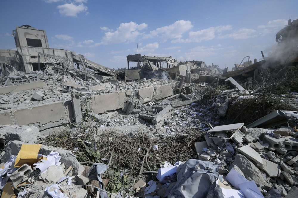 Debris surround the Syrian Scientific Research Center which was attacked by U.S., British and French military strikes to punish President Bashar Assad for suspected chemical attack against civilians, in Barzeh, near Damascus, Syria, Saturday, April 14, 2018. The Pentagon says none of the missiles filed by the U.S. and its allies was deflected by Syrian air defenses, rebutting claims by the Russian and Syrian governments. Lt. Gen. Kenneth McKenzie, the director of the Joint Staff at the Pentagon, also says there also is no indication that Russian air defense systems were employed early Saturday in Syria. (AP Photo/Hassan Ammar)