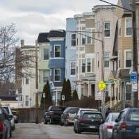 Triple-deckers along Edgewood Street in Dorchester. (Jesse Costa/WBUR)