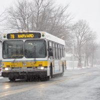 A bus makes it's way down a lonely Concord Ave. as snow begins to fall during a March 2017 storm. (Robin Lubbock/WBUR)