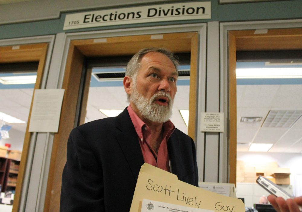 "After turning in some of his ballot signatures Tuesday afternoon, pastor Scott Lively called on his primary opponent Gov. Charlie Baker to ""come on out, come out of hiding"" and debate. (Sam Doran/SHNS)"