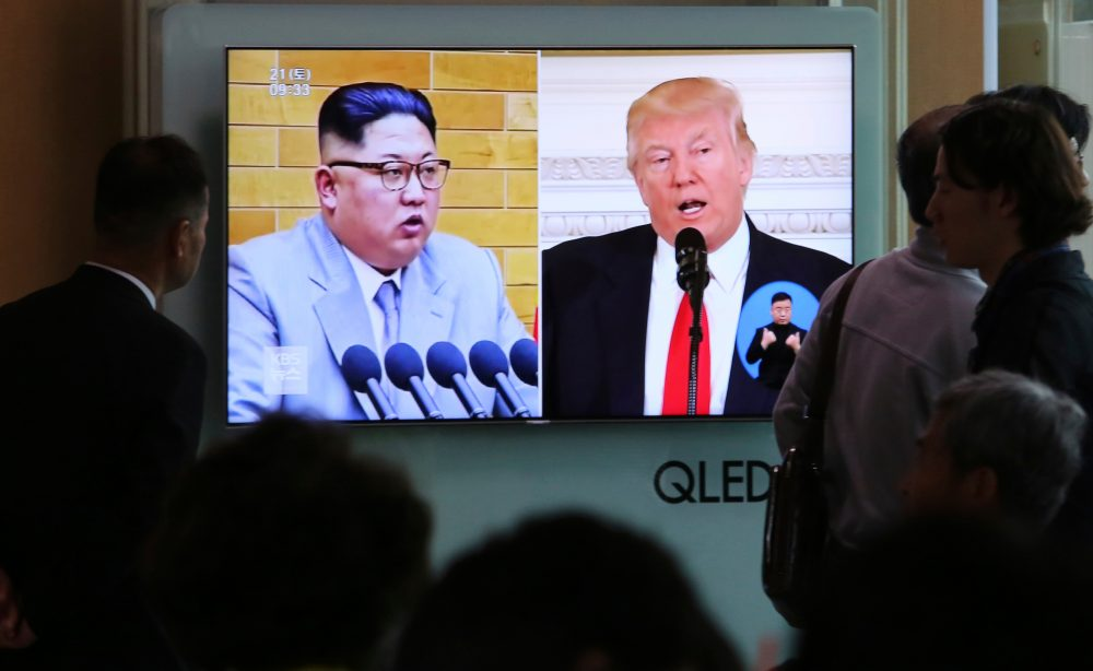 In this April 21, 2018 file photo, people watch a TV screen showing file footage of U.S. President Donald Trump, right, and North Korean leader Kim Jong Un during a news program at the Seoul Railway Station in Seoul, South Korea. (Ahn Young-joon, File/AP)