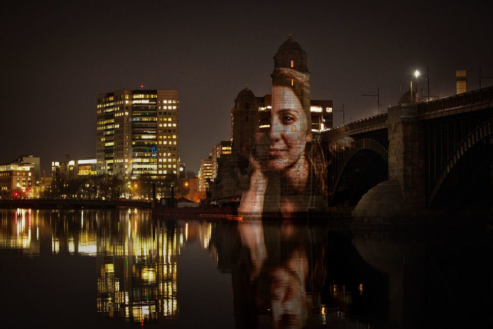 A portrait of computational biologist Pardis Sabeti projected on the Longfellow Bridge. (Courtesy Erik Jacobs)