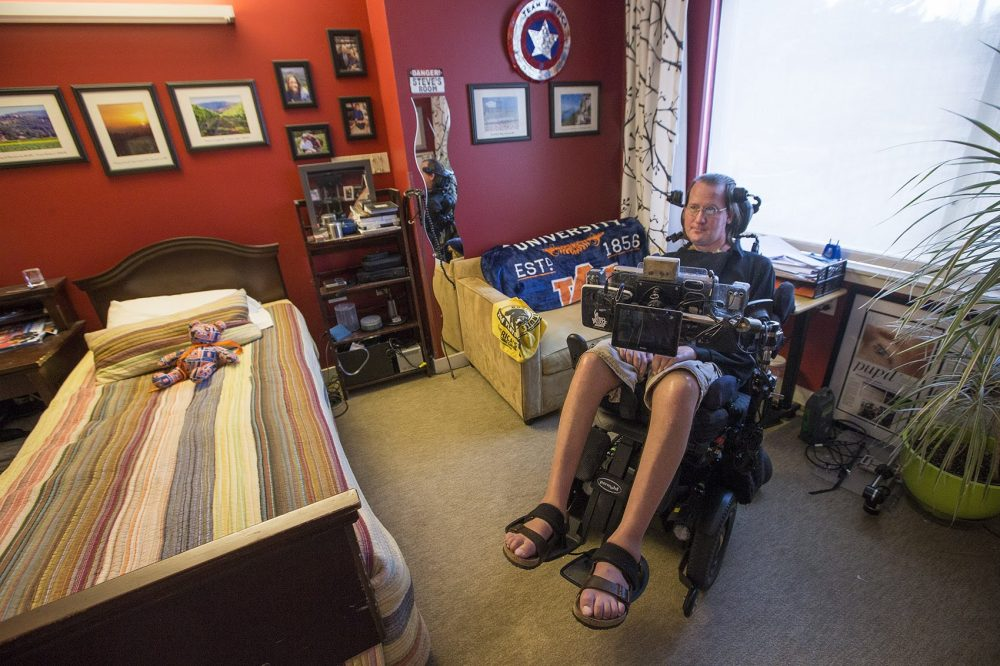 Steve Saling sits in his bedroom at the Leonard Florence Center For Living in Chelsea. (Jesse Costa/WBUR)