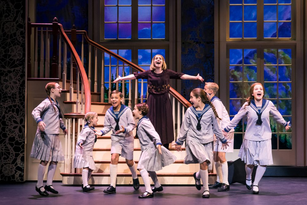 Jill-Christine Wiley as Maria Rainer and the von Trapp children. (Courtesy Matthew Murphy)