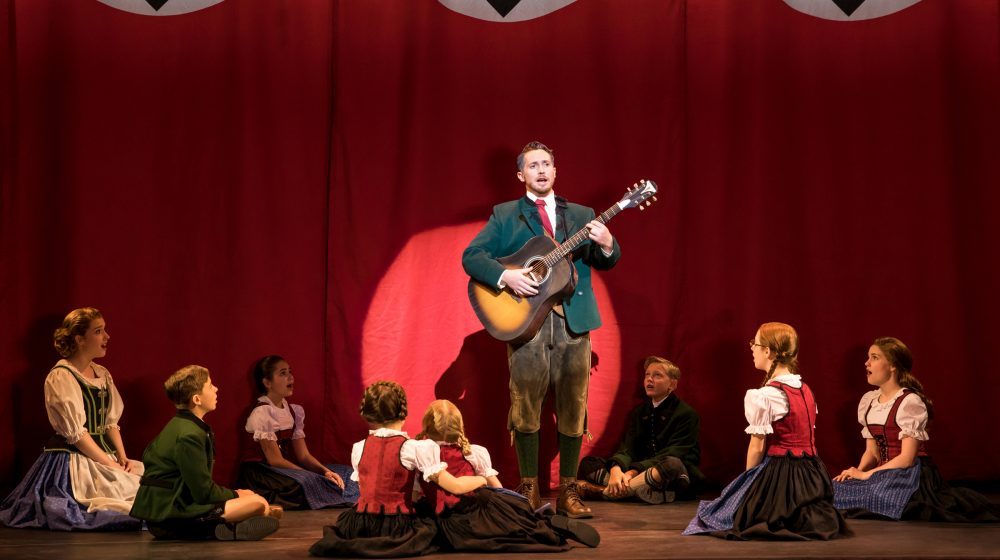 Mike McLean as Captain von Trapp and the von Trapp Family. (Courtesy Matthew Murphy)