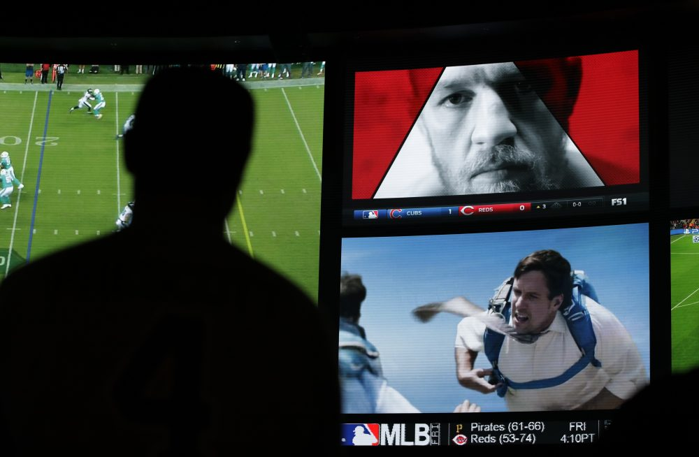 An ad featuring Conor McGregor plays on a screen at the Westgate Superbook sports book, Thursday, Aug. 24, 2017, in Las Vegas. (John Locher/AP)
