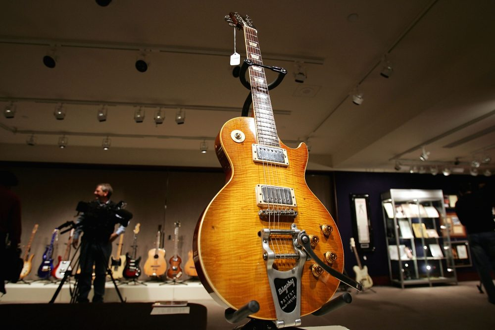 A guitar, once owned and used by Keith Richards of the Rolling Stones, stands on display at Christie's December 10, 2004 in New York City. (Spencer Platt/Getty Images)