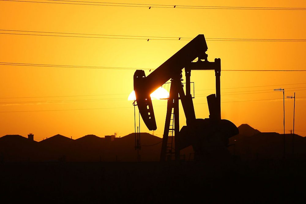 A pumpjack  sits on the outskirts of town at dawn in the Permian Basin oil field on January 21, 2016 in the oil town of Midland, Texas. (Spencer Platt/Getty Images)