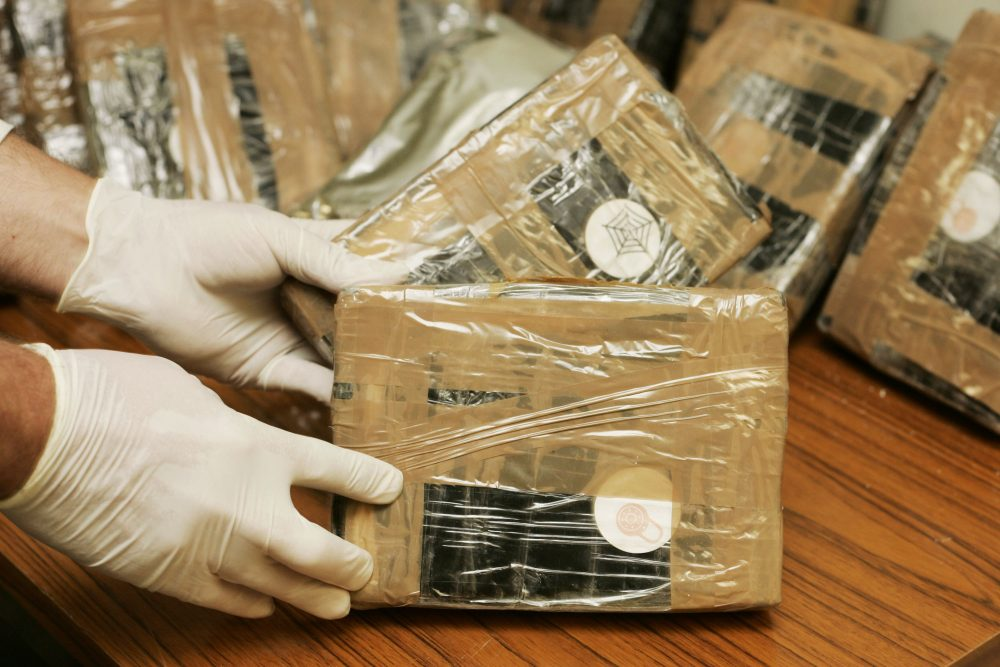 Confiscated bags containing cocaine are displayed. (Mark Renders/Getty Images)