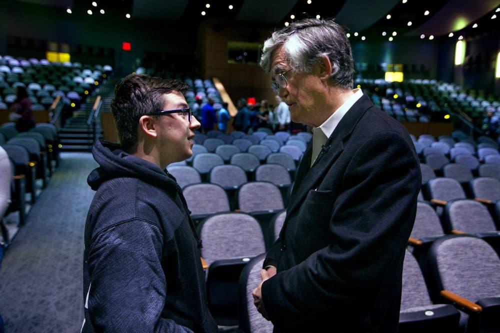 Sophomore C. J. Murphy speaks with Broderick after his presentation. (Jesse Costa/WBUR)