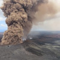 This Friday, May 4, 2018, aerial image released by the U.S. Geological Survey, at 12:46 p.m. HST, a column of robust, reddish-brown ash plume occurred after a magnitude 6.9 South Flank of Kilauea earthquake shook the Big Island of Hawaii, Hawaii. The Kilauea volcano sent more lava into Hawaii communities Friday, a day after forcing more than 1,500 people to flee from their mountainside homes, and authorities detected high levels of sulfur gas that could threaten the elderly and people with breathing problems. (U.S. Geological Survey via AP)