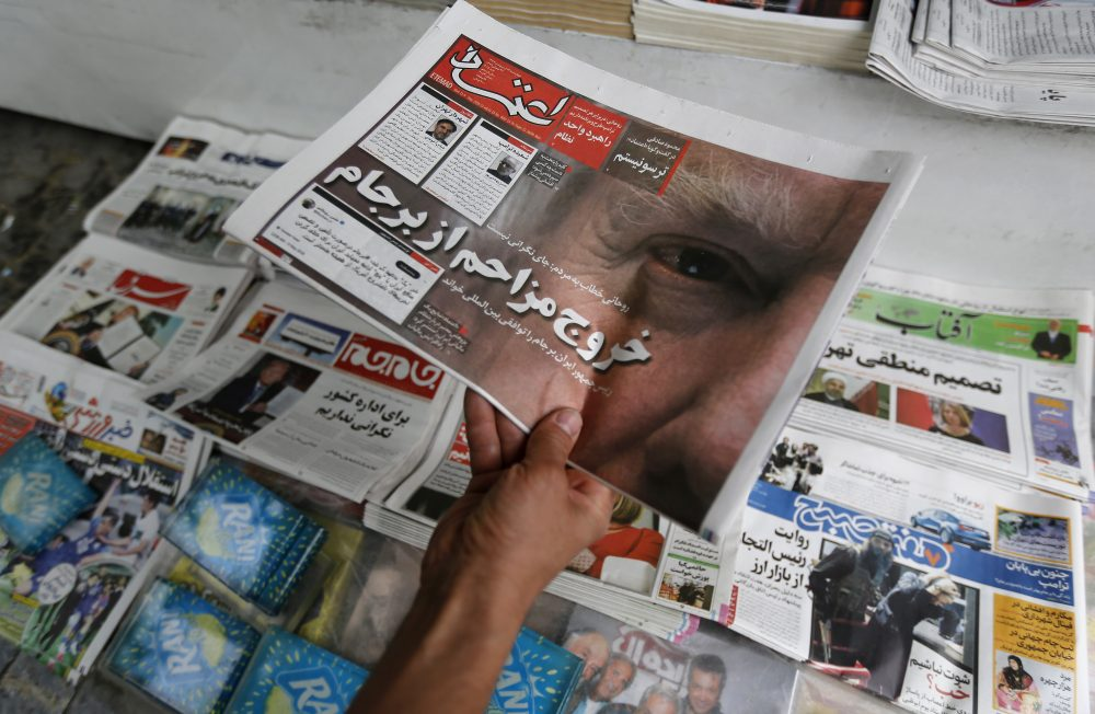 An Iranian displays the front page of a newspaper in Tehran on May 9, 2018 a day after President Trump announced the U.S. is pulling out of the nuclear deal. (Atta Kenare/AFP/Getty Images)