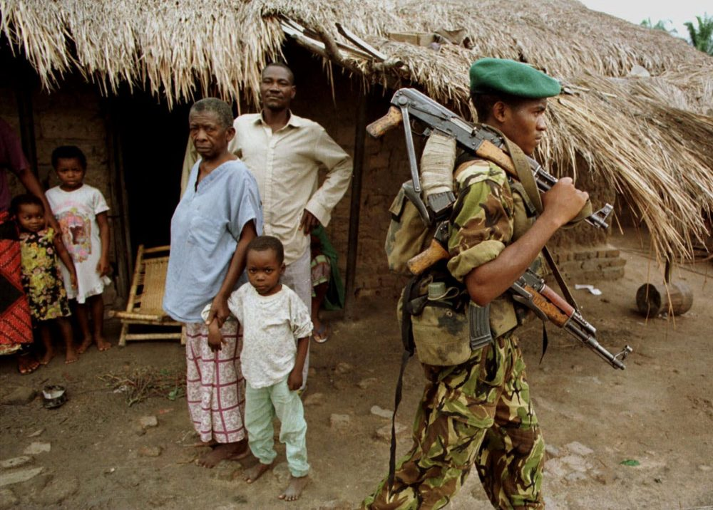 A Congolese rebel walks through the village of Kabalo, in eastern Congo, in November 1998. (Brennan Linsley/AP)