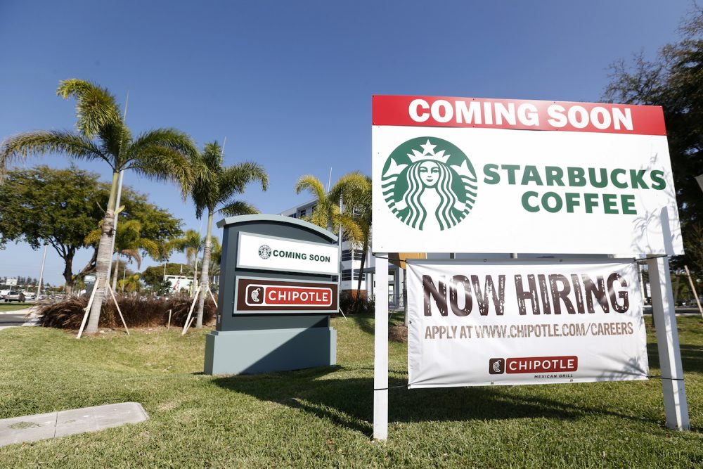 "In this Wednesday, April 26, 2017 photo, a ""Now Hiring"" sign for a new Chipotle Mexican Grill restaurant is shown in Miami. (Wilfredo Lee/AP)"