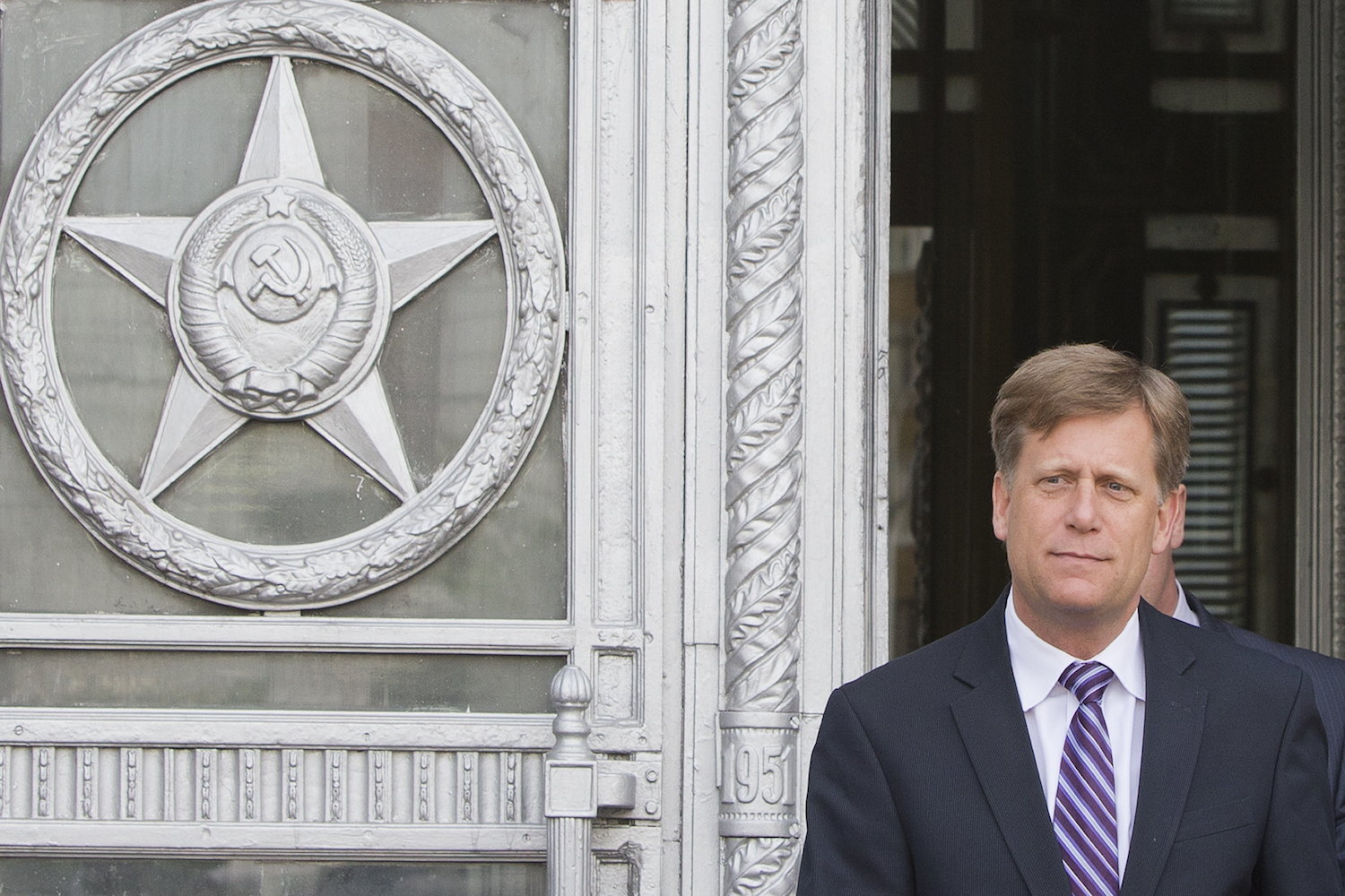 In this May 15, 2013 file photo, U.S. Ambassador to Russia Michael McFaul leaves the Foreign Ministry in Moscow, Russia. (Misha Japaridze/AP)