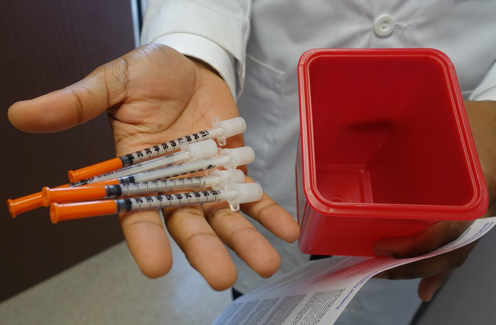 A doctor at the University of Miami holds needles on Nov. 30, 2016, that will be given away to people with drug addictions at a new syringe exchange program. (Kerry Sheridan/AFP/Getty Images)