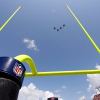 """""""They were all in on it: NASCAR, MLB, the NBA, the NFL, NHL, MLS, and the NCAA. The military was using sports to sell the business of war,"""" Howard Bryant writes. Pictured: Fighter jets fly over Raymond James Stadium just prior to the start of the game between the Tampa Bay Buccaneers and the Cleveland Browns. (J. Meric/Getty Images)"""