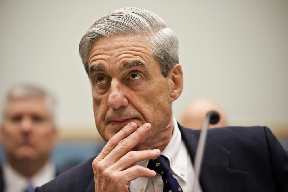 FBI Director Robert Mueller listens as he testifies on Capitol Hill in Washington in June 2013. (J. Scott Applewhite/AP)