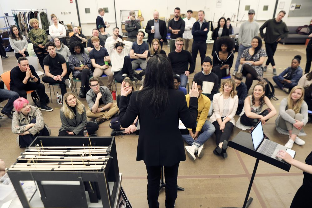 "Director Diane Paulus speaks with the company during the first rehearsal of ""Jagged Little Pill."" (Courtesy Jimmy Ryan/A.R.T.)"