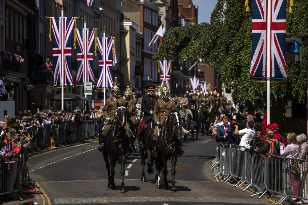 Members of the armed forces ride horses during a parade rehearsal, ahead of Prince Harry and Meghan Markle's wedding in Windsor, England, Thursday, May 17, 2018. Preparations continue in Windsor ahead of the royal wedding of Britain's Prince Harry and Meghan Markle Saturday May 19. (AP Photo/Emilio Morenatti)