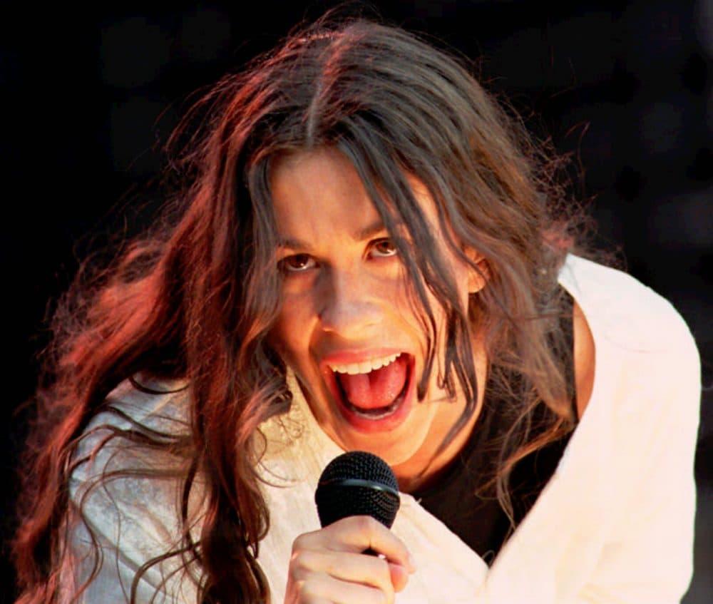 Alanis Morissette performs in London on June 29, 1996. (Stefan Rousseau/AP)
