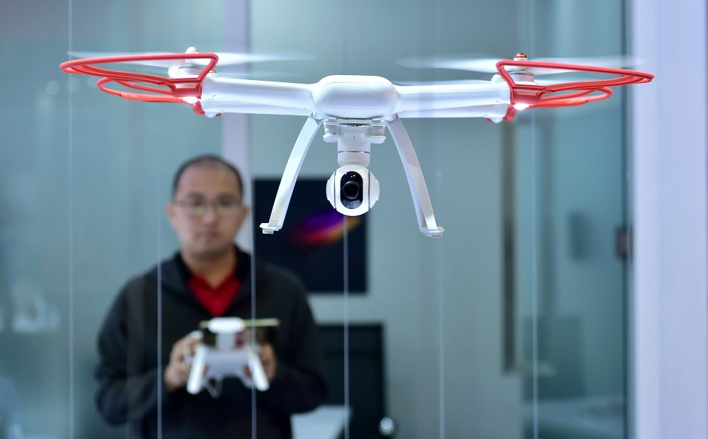 A man flies the remote control Mi Drone from Xiomi, during the 2017 Consumer Electronic Show (CES) in Las Vegas in 2017. (Frederic J. Brown/AFP/Getty Images)