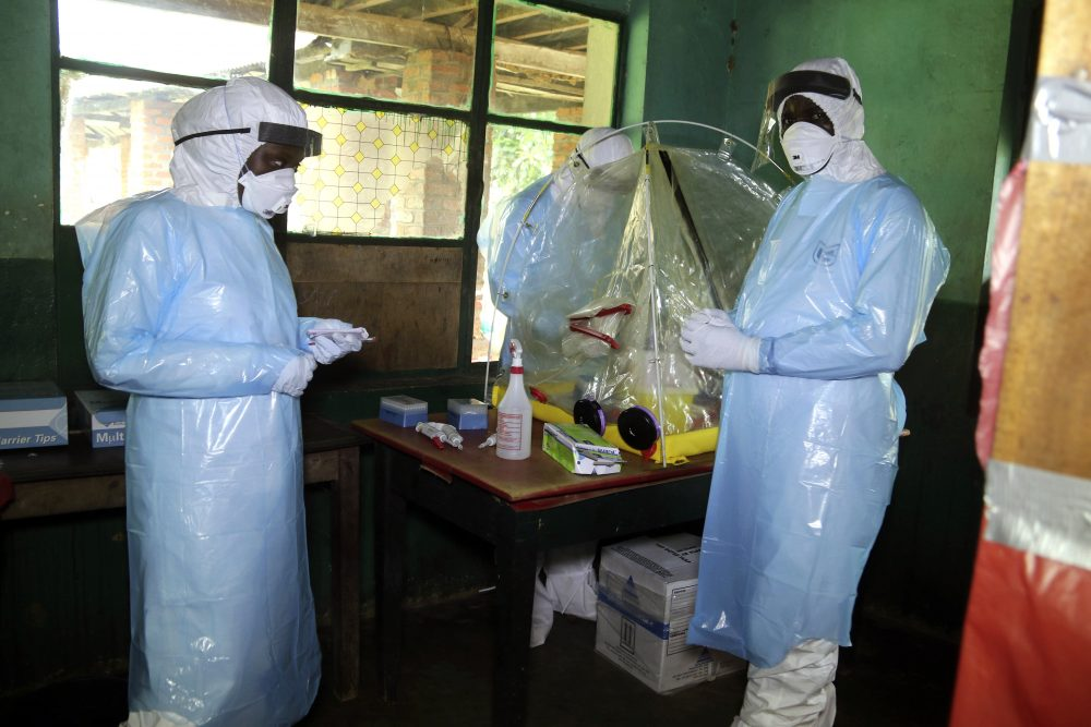 In this photo taken on Sunday, May 13, 2018, health care workers wear virus protective gear at a treatment center in Bikoro Democratic Republic of Congo. Congo's latest Ebola outbreak has spread to a city of more than 1 million people, a worrying shift as the deadly virus risks traveling more easily in densely populated areas. (John Bompengo/AP)