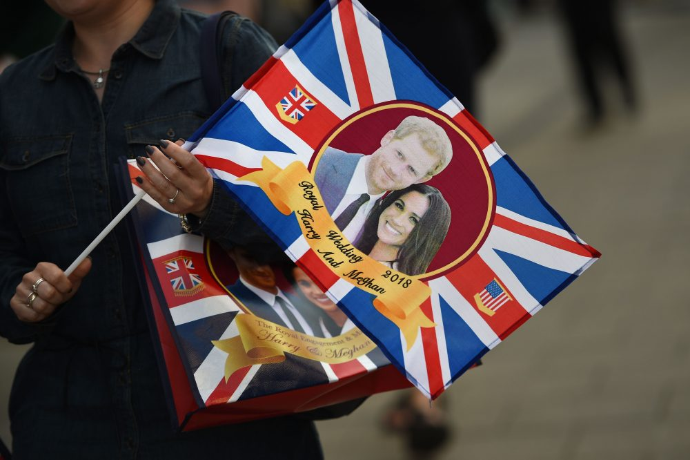 A visitor carries a bag featuring Britain's Prince Harry and Meghan Markle in Windsor, England, on May 17, 2018, two days before the royal wedding. (Oli Scarff/AFP/Getty Images)