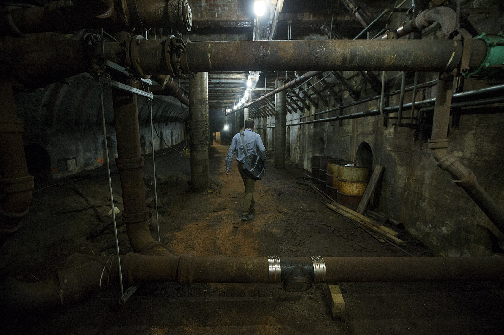 City of Boston archaeologist Joe Bagley walks through the first of two sections of an old MBTA tunnel, which traveled between Scollay Square and Adams Square, and is believed to have been shut down in 1963. (Jesse Costa/WBUR)