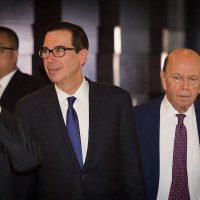 U.S. Treasury Secretary Steven Mnuchin (left) and U.S. Commerce Secretary Wilbur Ross (right) walk through a hotel lobby as they head to the Diaoyutai State Guest House to meet Chinese officials for ongoing trade talks in Beijing on May 4, 2018. (Nicolas Asfouri/AFP/Getty Images)