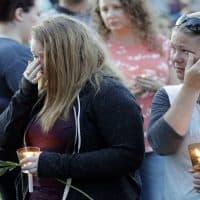 Santa Fe High School freshman Kylie Trochesset, left, and her mother, Ashlee, wipe away tears during a prayer vigil following a shooting at Santa Fe High School in Santa Fe, Texas, on Friday, May 18, 2018. /David J. Phillip/AP)