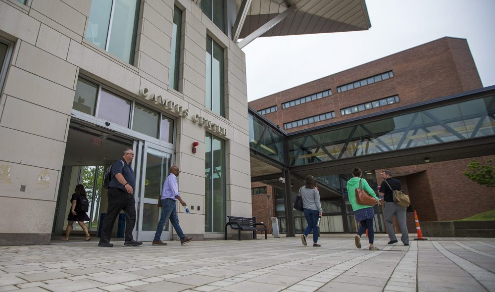Students and faculty walk out of the Campus Center at UMass Boston. (Jesse Costa/WBUR)