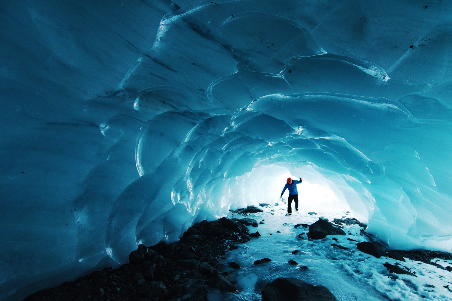 Skating in a small ice cave below Byron Glacier, in the Chugach National Forest of Alaska. (Paxson Woebler/Unsplash)