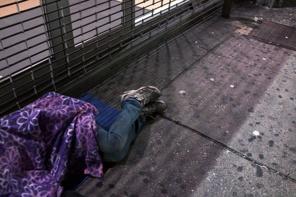 A homeless person sleeps on a Manhattan street on Aug. 22, 2014 in New York City. (Spencer Platt/Getty Images)