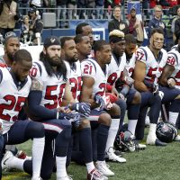 Houston Texans players kneel during the singing of the national anthem before an NFL football game against the Seattle Seahawks, Sunday, Oct. 29, 2017, in Seattle. (Elaine Thompson/AP)