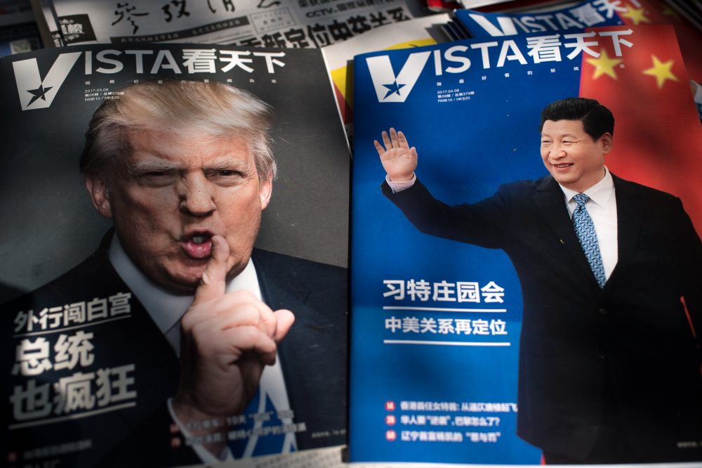 Magazines featuring front pages of President Trump and China's President Xi Jinping are displayed at a news stand in Beijing on April 6, 2017. (Nicolas Asfouri/AFP/Getty Images)