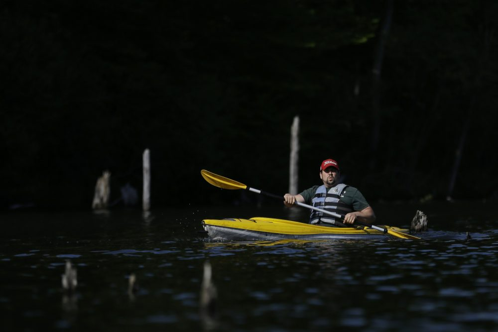 A man kayaks on Monksville Reservoir, Sunday, May 21, 2017, in Hewitt, N.J.. as the region gears up for the summer season kicking off on Memorial Day weekend. (Julio Cortez/AP)