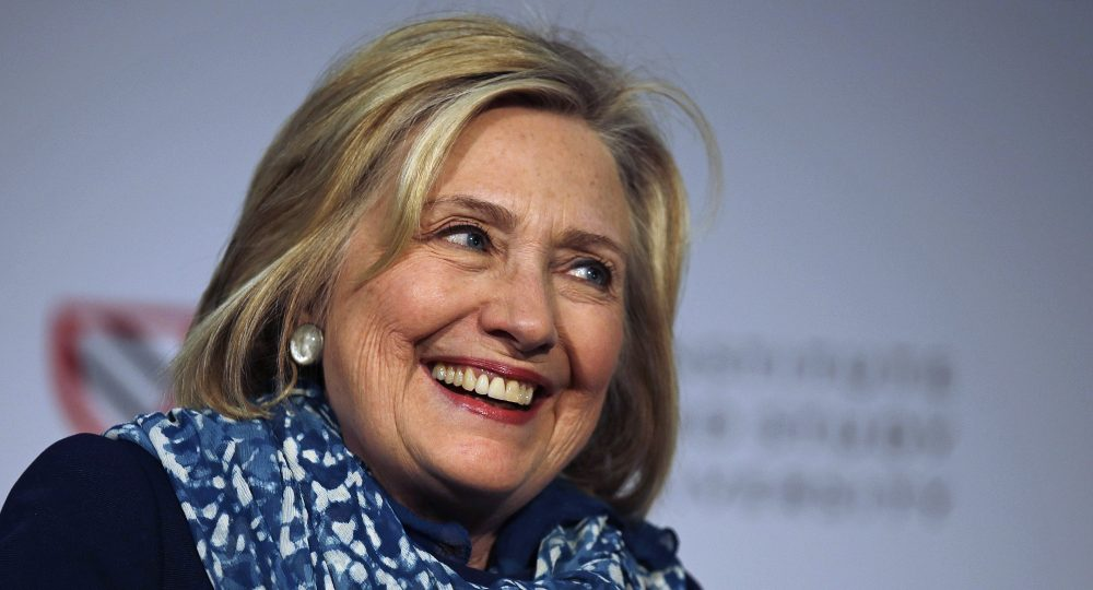 Hillary Clinton smiles as she is introduced at Harvard University in Cambridge, Mass. on Friday. (Charles Krupa/AP)