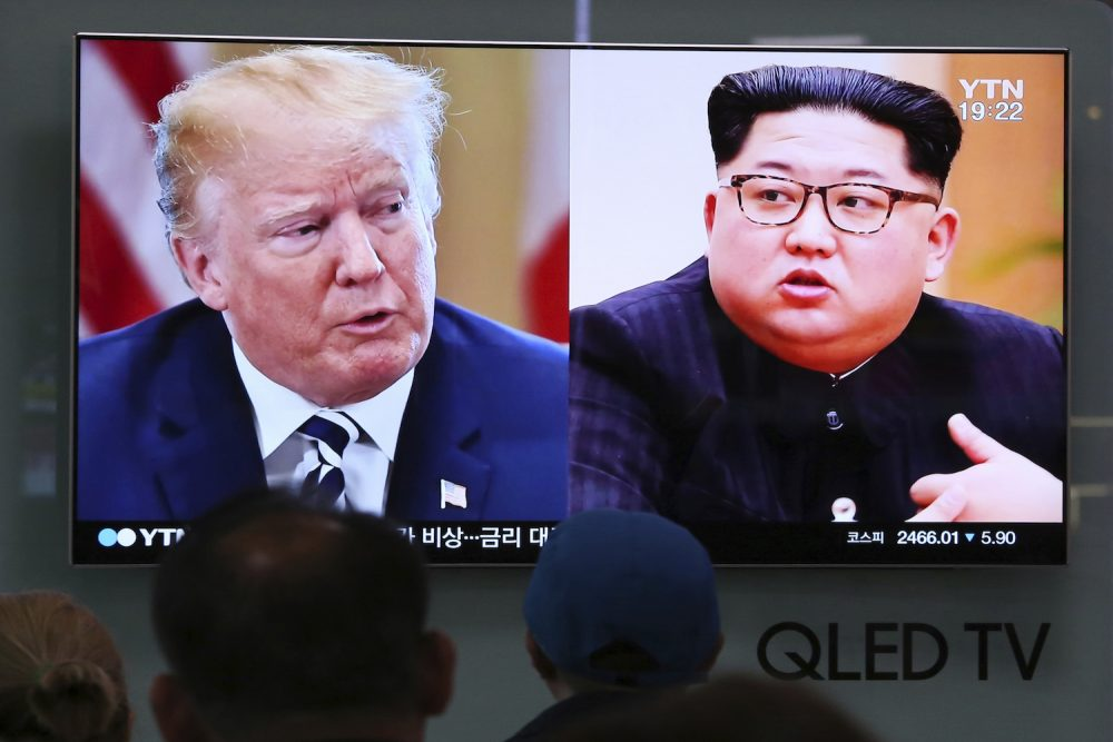 People watch a TV screen showing file footage of U.S. President Donald Trump, left, and North Korean leader Kim Jong Un during a news program at the Seoul Railway Station in Seoul, South Korea, Thursday, May 24, 2018.  (Ahn Young-joon/AP)