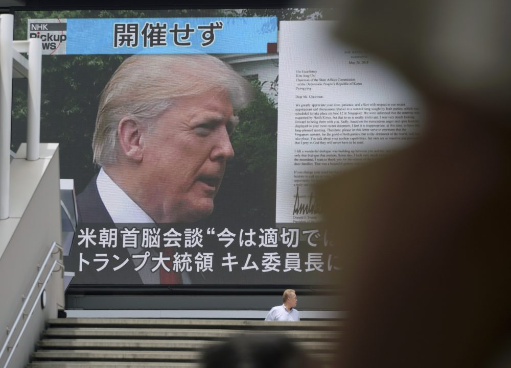 """A TV screen showing President Trump, right, in Tokyo, Friday, May 25, 2018. President Donald Trump on Thursday abruptly canceled his summit with North Korea's Kim Jong Un, blaming """"tremendous anger and open hostility"""" by Pyongyang — a decision North Korea called """"regrettable"""" while still holding out hope for """"peace and stability."""" (Eugene Hoshiko/AP)"""